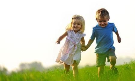 boy-girl-running-field