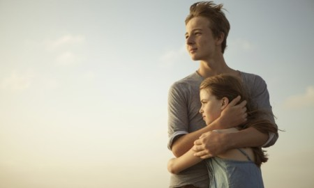 Brother and sister giving an hug on the beach