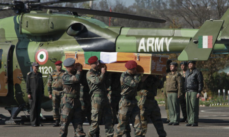 Indian army soldiers carry the coffin of Army Captain Tushar Mahajan in Udhampur's military station, Monday, Feb. 22, 2016. Mahajan died from injuries sustained during a gunbattle between Kashmiri rebels and Indian government forces in the Pampore area, Indian-controlled Kashmir. Anti-India sentiment runs deep in India's portion of Kashmir, where rebel groups have been fighting since 1989 for either independence or a merger with neighboring Pakistan. More than 68,000 people have been killed in the armed uprising and ensuing Indian military crackdown. (AP Photo/Channi Anand)