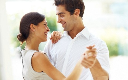 Young romantic couple dancing