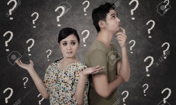 19250397-Confused-couple-with-question-marks-on-blackboard-Stock-Photo