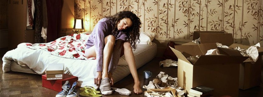 landscape-1465802419-woman-in-messy-bedroom